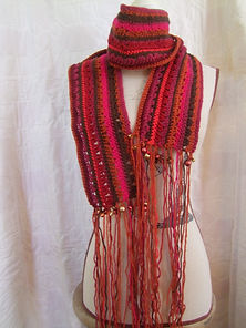 Crocheted scarf with hand beaded trim £1