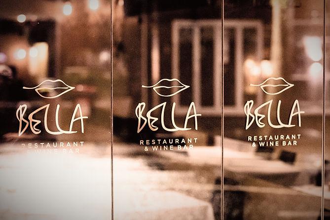 Bella Restaurant Wine Bar Main Entnrance logo logos window