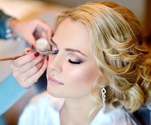 main-makeup-artist-applying-bridal-makeu