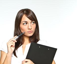 woman-thinking-holding-clipboard.jpg