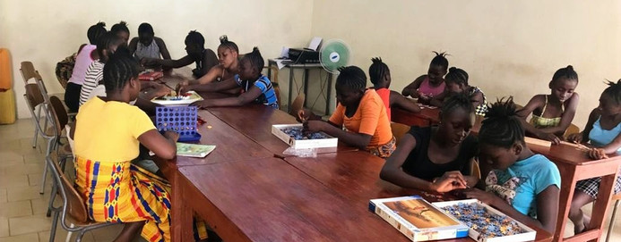The girls enjoy having a common room, where they can play games, talk or...