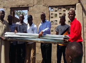 Alton Bendu Rescues over five Hundred Pupils… Providing bundles of zinc to reroof Bumpeh Academy