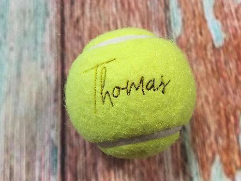 Gravierte Tennisbälle