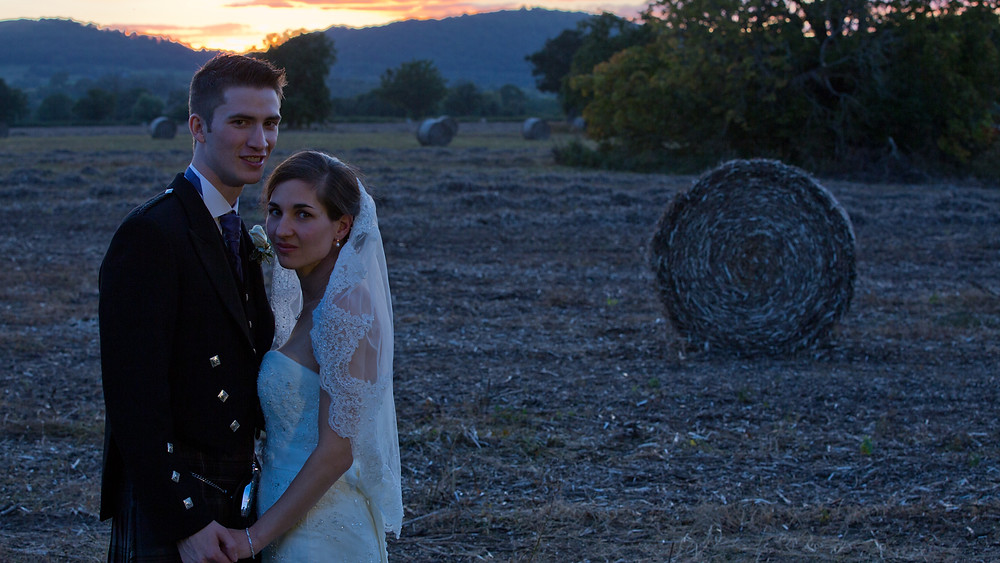 An stuning sunset creates the perfect end to their cinematography wedding film.