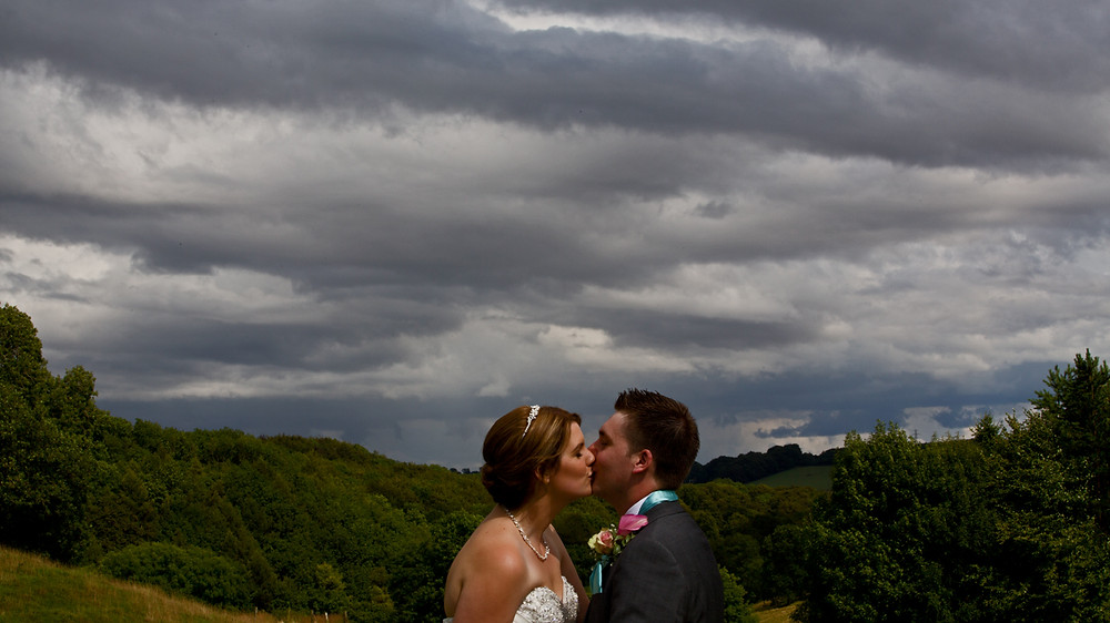 The happy couple in stormy clouds was captured in their wedding video.