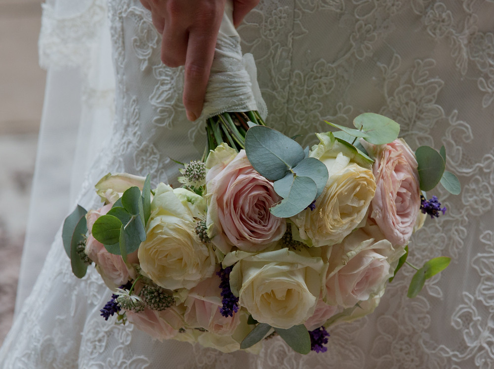 Worcestershire wedding videographer capturing delicate florals for the bride.