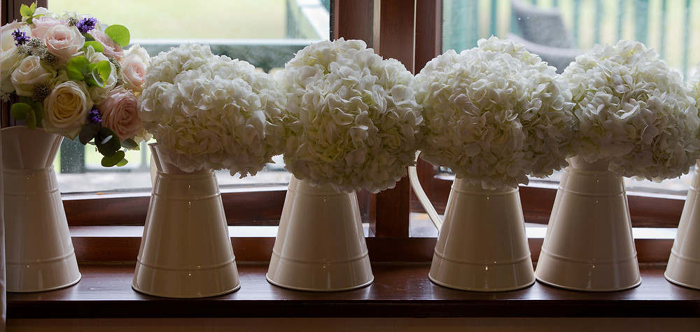 We love these vintage wedding flowers in the Cotswolds.