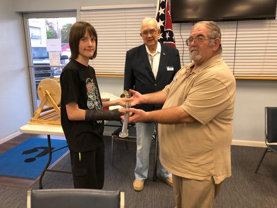 Trenton Messer presenting the Ceremonial Dress Sword to Camp Treasurer Robert W. Yancy.