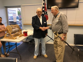 Lieutenant Commander Ferrell Mikell thanking Adjutant James E. Tucker, Sr. for the wonderful gift.