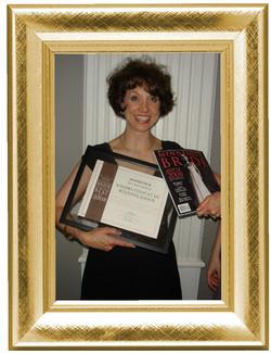 Sondra holding Awards and Magazine