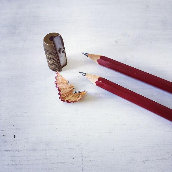 Sharpened Pencils with Metal Bullet Pencil Sharpener and Pencil Shavings