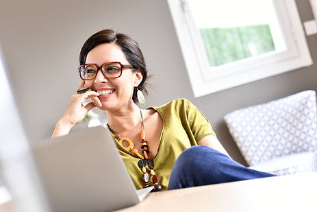 Trendy woman working on laptop from home.jpg