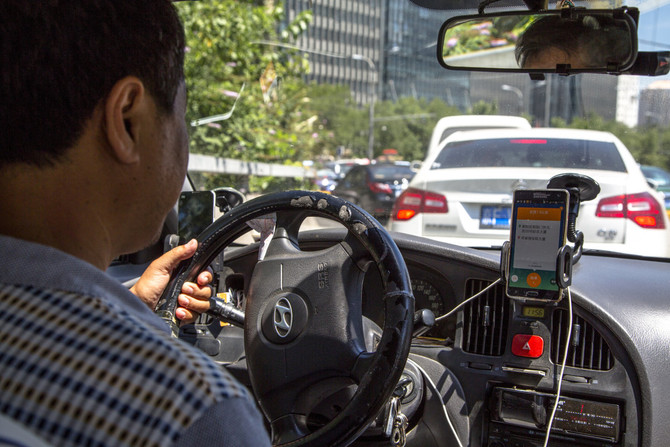 Apple invests $1 billion in Chinese ride-hailing service Didi