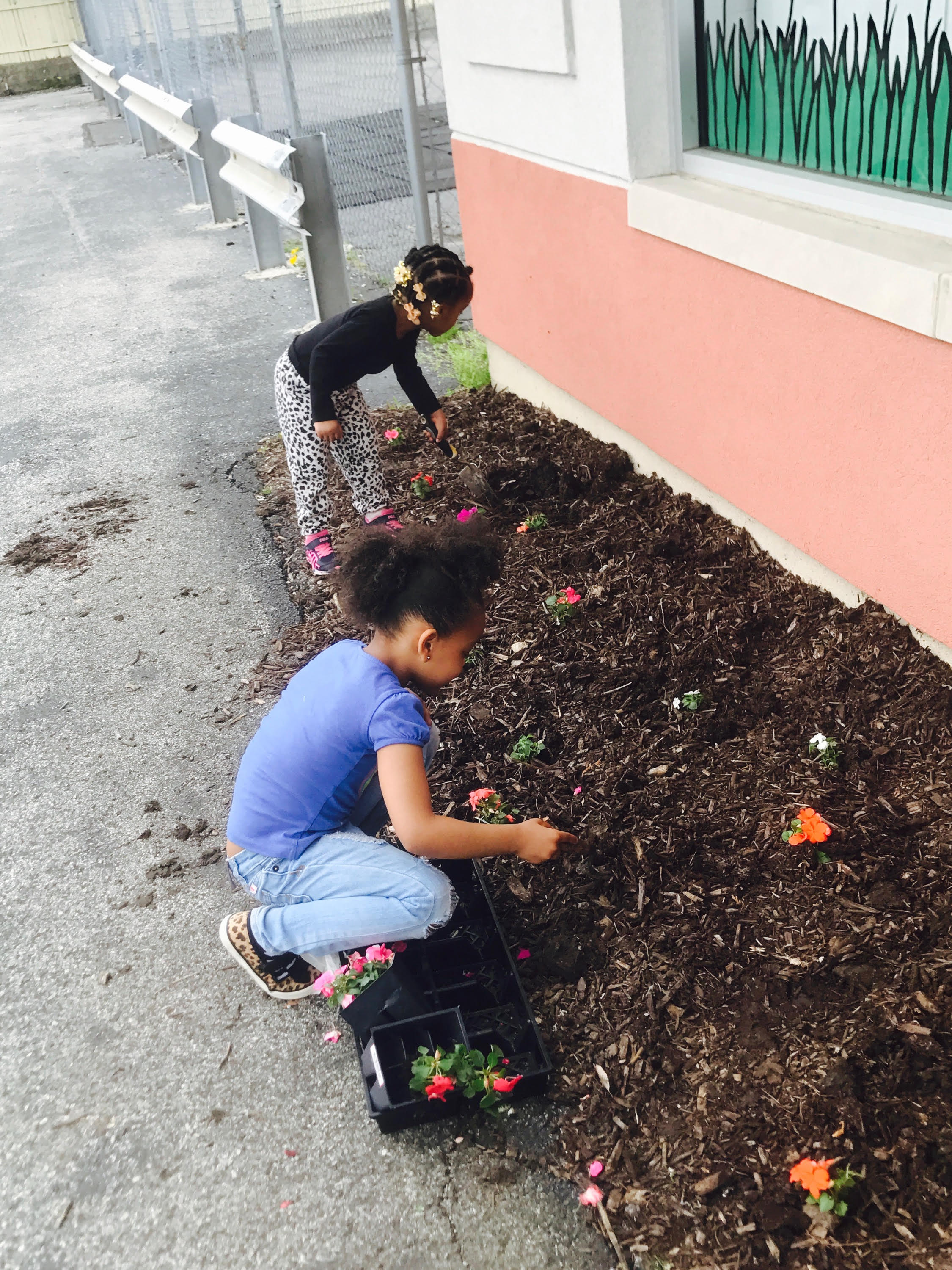 Planting flowers at First Years University daycare in homewood
