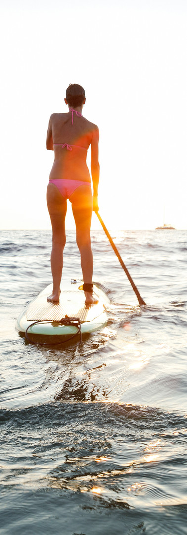 Girl on SUP at sunset