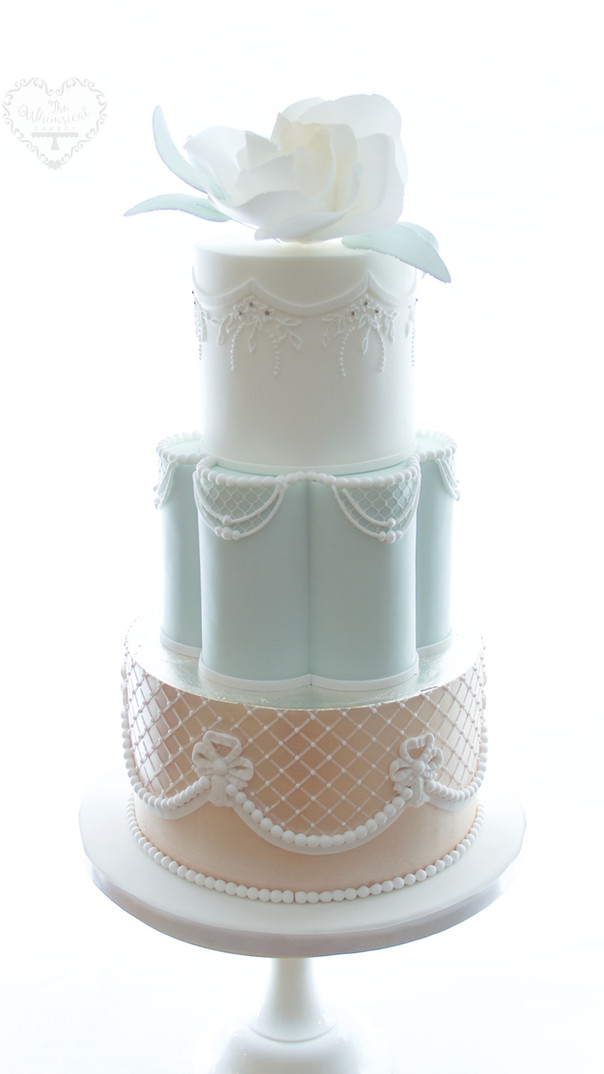Petal tier and piping wedding cake