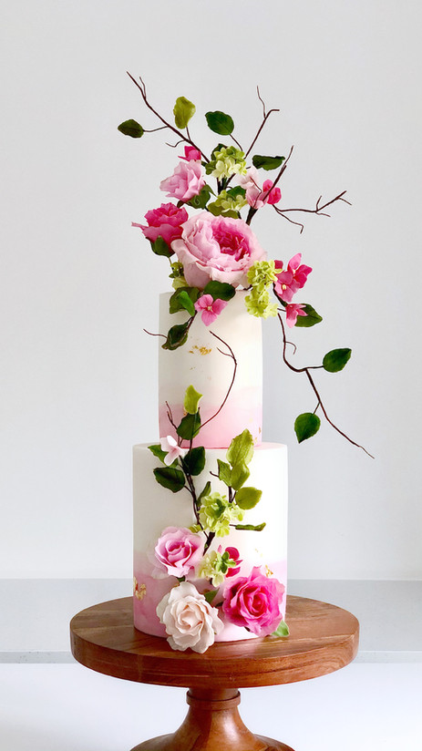 Trailing flowers wedding cake