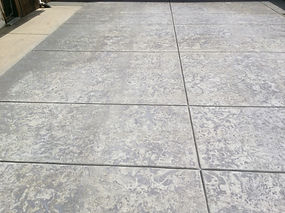 color can reduce glare from concrete that is plain lite in natural state.
