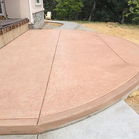 Rounded patio with sidewalks next to deck