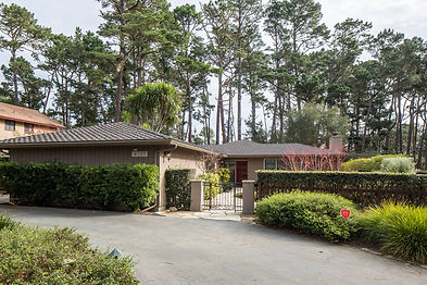Surrounded by beautiful Monterey Pines, this recently updated single-level home in Pebble Beach's Upper Forest area awaits its next fortunate owner. Privately situated on a flat .25 acre lot, with ample outdoor entertaining areas – including two stone patios with fireplaces, a putting green and calming water feature – this ranch-style home could be your next oasis in the forest. Large windows surround the living, dining and family rooms bringing in plenty of natural light, each with French Doors that flow to the surrounding outdoor entertaining areas.  This home has four bedrooms and three bathrooms, including a large master suite with its own fireplace and walk-in closet, plus a two car garage, laundry room and abundant off-street parking.  Truly a turn-key property!