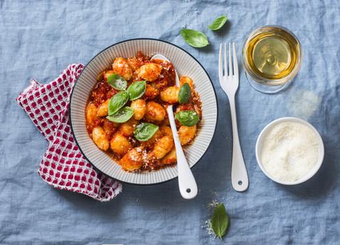 Potato gnocchi in tomato sauce with basi