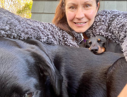 Snuggling on the outdoor chaise for a no-make-up day in cold Appalachian mountains. Louie sleeping i