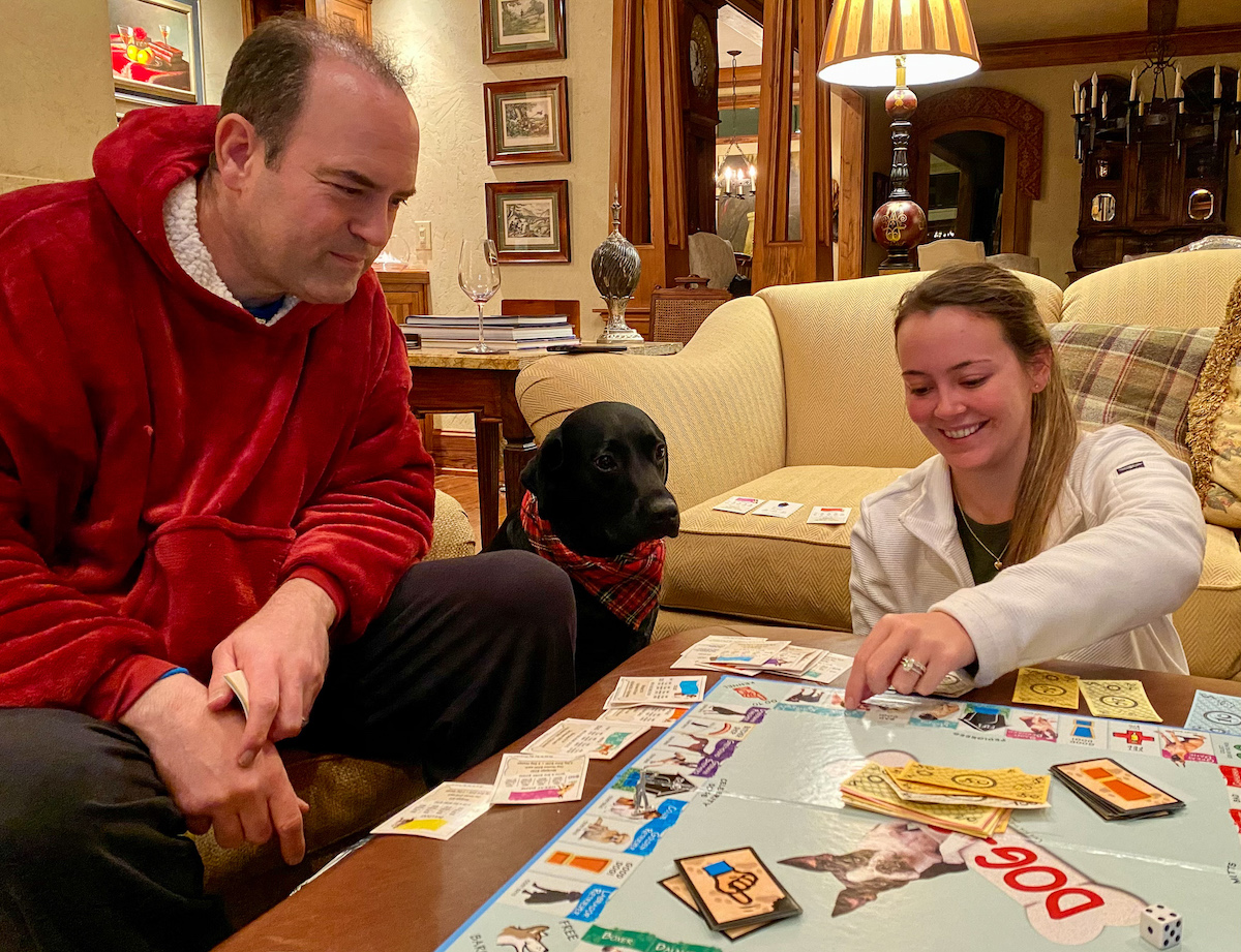 Playing Dog-opoly. Colonel advises Cecelia to buy the property!