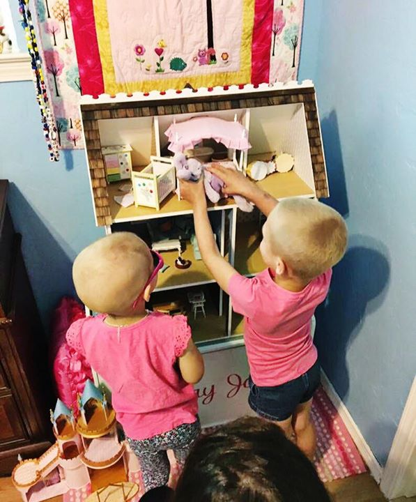 Avery and Lily playing with the dollhouse Sadie (the Sadie Keller Foundation) bought Avery for her e