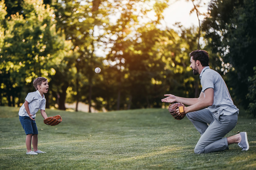 A father and son playing catch