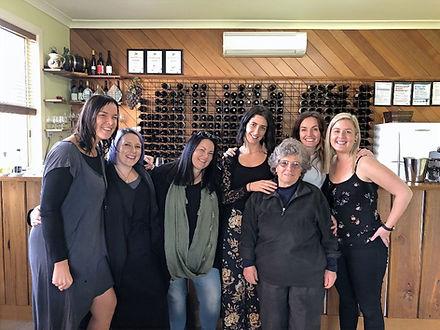 Happy people tasting wine