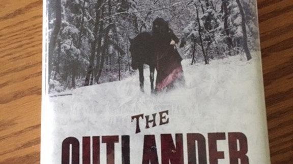 THE OUTLANDER -- GIL ADAMSON