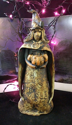 12 inch sepia witch holding 3 pumpkins
