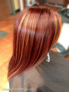 Gorgeous cherry red hair featuring pops of copper and blonde highlights