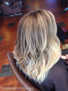 Ash and platinum blonde hairstyle with beachy waves