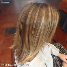 Strawberry blonde highlights give this blonde beautiful dimension