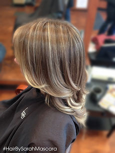 Dimensional blonde. Neutral light brown blending into beige highlights through the ends