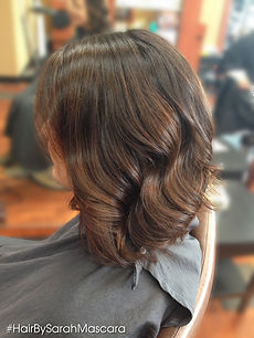 Subtle auburn highlights in dark brown hair
