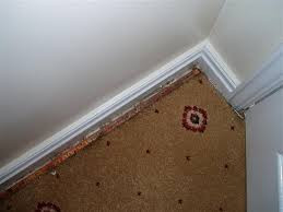 This is an example of carpet shrinkage.  You can clearly see the gripper rod.