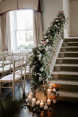 Staircase wedding flowers.JPG