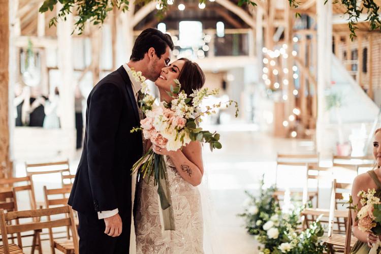 Couple kiss, wedding Florist Essex