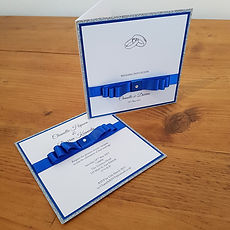 Royal blue, silver glitter and white wedding invitiation. Click to navigate to page featuring all designs.