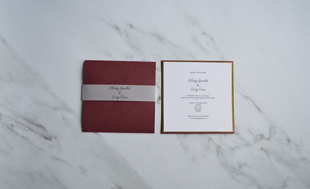 Burgandy red and gold wedding invitations with velum belly band