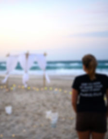 Wedding stylist on beach at sunset Stradbroke Island wedding