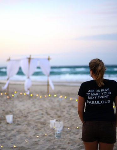 Wedding stylist on beach at sunset Stradbroke Island wedding