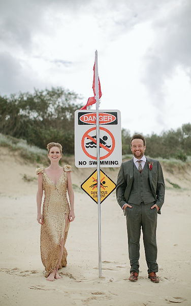 Bride and groom on stormy beach stradbroke island wedding