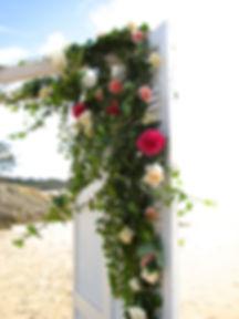 Wedding ceremony vintage arch with roses and ivy stradbroke island wedding