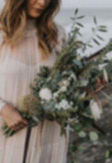 Beautiful rose and jasmine bride's bouquet on beach stradbroke island wedding