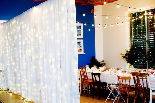 Vintage lace curtain hire with fairy lights Brisbane hire wedding Stradbroke Island Hotel