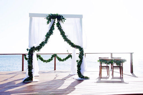 White wooden wedding arbour with white draping hire Brisbane wedding styling with foliage garlands