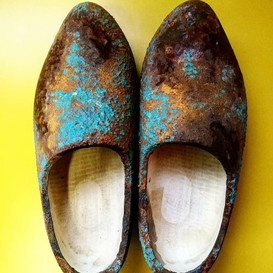 Artistic rusted shoes with yellow background
